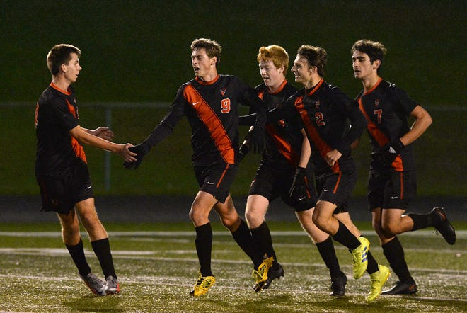 Fairview's Nathan George, center, celebrates his goal against Mercyhurst Prep in the District 10, Region 3 boys soccer game Thursday at Fairview's Keck Field at Bestwick Stadium.