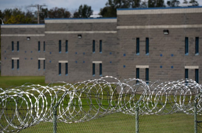 Razor wire surrounds the perimeter of the Erie County Prison, at East 18th and Ash streets.