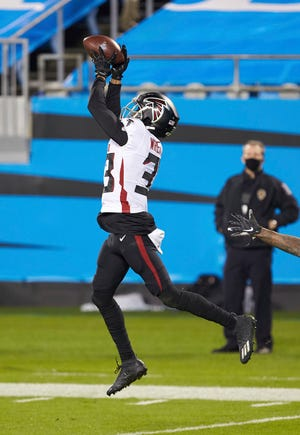 Atlanta Falcons defensive back Blidi Wreh-Wilson (33) intercepts a pass to seal the win over the Carolina Panthers on Thursday, Oct. 29, 2020, in Charlotte, N.C.