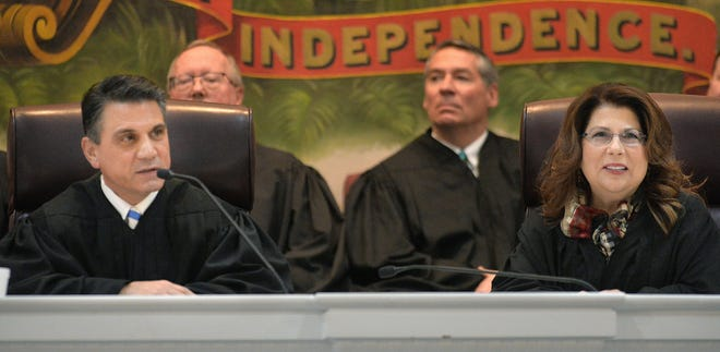 Erie County President Judge John J. Trucilla, at left, and Erie County Judge Stephanie Domitrovich, at right, are shown during a swearing-in ceremony for other elected officials on Jan. 3 in Courtroom H at the Erie County Courthouse.