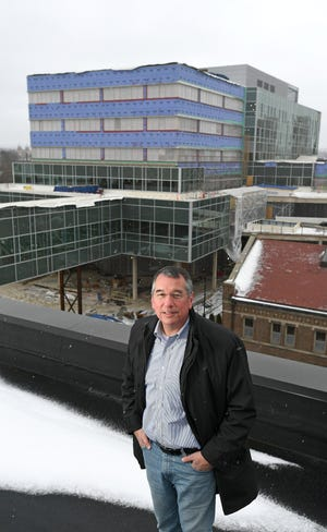 Tim NeCastro, CEO of Erie Insurance, is shown on the roof of the company's Perry Square headquarters in downtown Erie in January 2019. NeCastro talked about investing in Erie during the two-day Erie Homecoming.