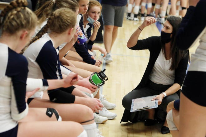 Notre Dame High School's head coach Susan Reid talks with players during their match against Van Buren High School, Tuesday Oct. 6, 2020 at Notre Dame's Father Minett gymnasium.