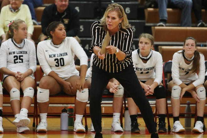 New London volleyball coach Maureen Heath gives instructions to players during their match against Fort Madison High School, Thursday Sept. 10, 2020 at Fort Madison.