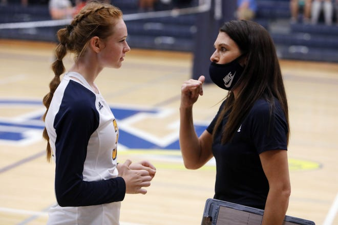 Notre Dame High school's head coach Susan Reid talks with Abby Korschgen (31) during their match against Holy Trinity High School,Tuesday Sept. 15, 2020 at Notre Dame's Father Minett gymnasium.