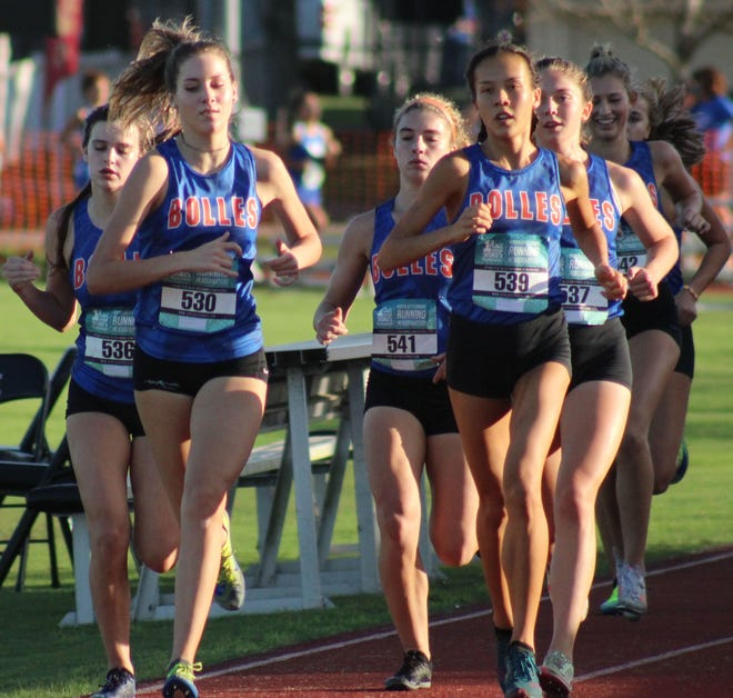 Bolles runners (from left) Ella Mickler, Jillian Candelino, Layne Rivera, Maddie Popp and Maxine Montoya lead the field at the start of the FHSAA District 4-2A girls cross country race at Bishop Kenny High School on October 28, 2020. [Clayton Freeman/Florida Times-Union]