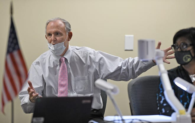 Duval County Supervisor of Elections Mike Hogan addresses a question during Friday afternoon's canvassing board meeting after issues were raised with the previous evaluation of questionable ballots.