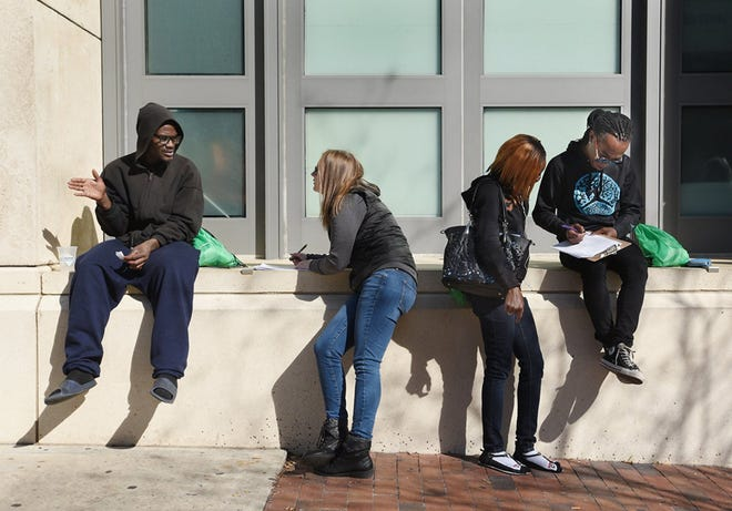 Outside the Main Library in downtown Jacksonville, volunteers conduct interviews for Northeast Florida's annual homeless count in 2018.