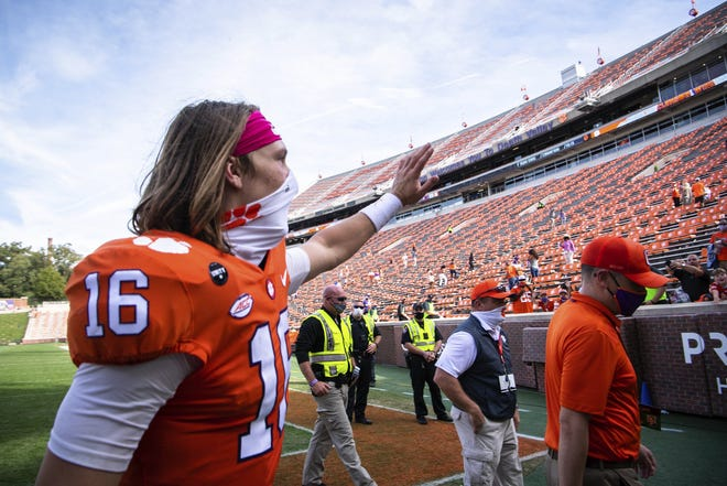 Clemson quarterback Trevor Lawrence, seen here waving to fans after last week's win over Syracuse, is the face of college football and is highly scrutinized. He knew the risks of playing college football amid a coronavirus pandemic and leading a player movement to get back on the field, but he deserves no criticism just because he has now tested positive for COVID-19.