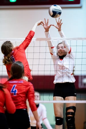 Pottsboro's Hannah Fellinger puts up a block against Prairiland's Reese Parris in a 3A Region II bi-district match at Princeton.