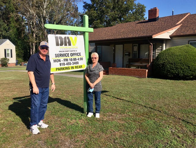 Former Marine Randall Cox, Commander of Disabled American Veterans (DAV) Onslow County Chapter 16, and his wife Sherrie, Commander of the chapter's Auxiliary Unit, pose for a photo outside of the nonprofit's office located at 300 Sherwood Rd. in Jacksonville, Oct. 28.