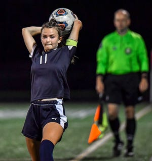 Twinsburg captain Tara Garing throws the ball in during a game earlier this season. The Tigers won the district title with a 2-1 win at Walsh Jesuit Oct. 29.