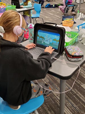 Third grader Philomena Novelli in Mrs. Anne Knutty's class uses the new math software program purchases with a donation from the Tallmadge Historical Society.