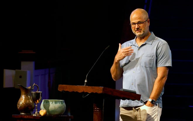 In this Aug. 23 photo provided by Steve NeSmith, Scott Sauls, senior pastor at Christ Presbyterian Church, preaches to his congregation in Nashville, Tenn.