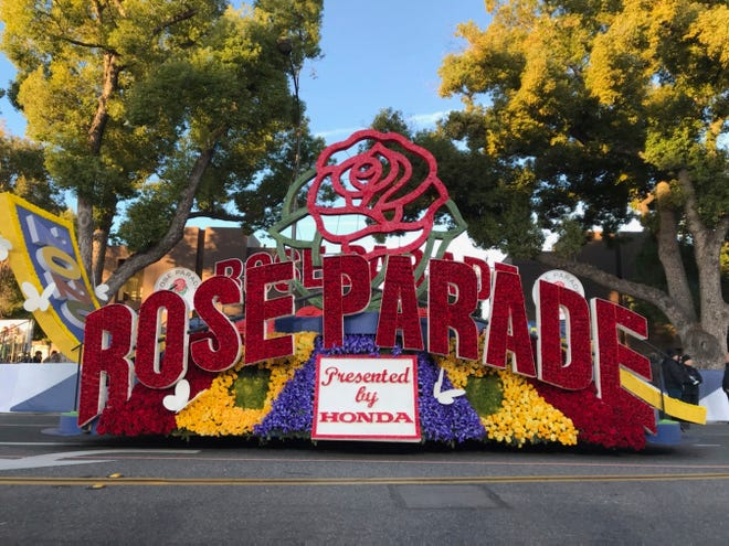 """A 2020 Rose Parade float waits at the start of the route at the 131st Rose Parade in Pasadena, Calif., on Jan. 1. The 2021 Rose Parade is canceled because of the coronavirus pandemic, but viewers will still get a show with a two-hour television special on New Year's Day, organizers said. The Tournament of Roses Association said in a Thursday news release that the TV special will include """"live-to-tape musical and marching band performances, heartwarming segments related to the Rose Parade, celebrity guest appearances,"""" and highlights from past Rose Bowl football games."""