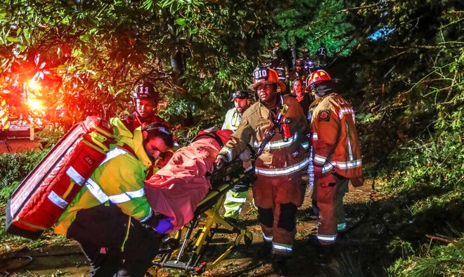 Atlanta fire crews worked for to free a man trapped in his third-floor bedroom after a tree came crashing down on a home Thursday, Oct. 29, 2020 in Atlanta. Rain bands and damaging winds from Tropical Storm Zeta swept through North Georgia on Thursday morning, leaving nearly 1 million in the dark.
