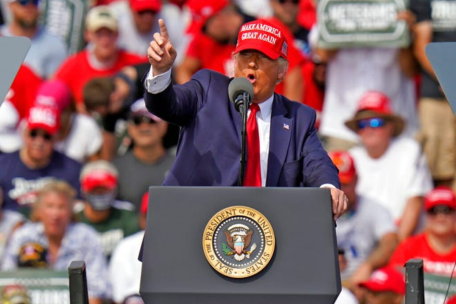 President Donald Trump gestures during a campaign rally Thursday, Oct. 29, 2020, in Tampa.