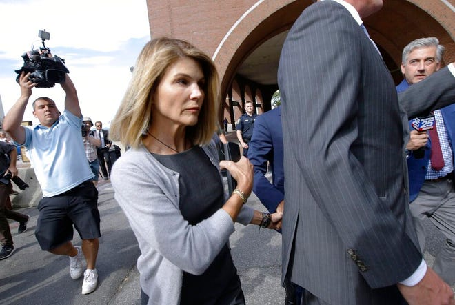"FILE - In this Aug. 27, 2019, file photo, actress Lori Loughlin departs federal court in Boston, after a hearing in a nationwide college admissions bribery scandal. Authorities say the ""Full House"" actress has reported to a federal prison in California to begin serving her two-month sentence for her role in the college admissions bribery scandal. The U.S. Attorney's office in Boston said Friday that Loughlin was being processed at the federal lockup in Dublin, California."