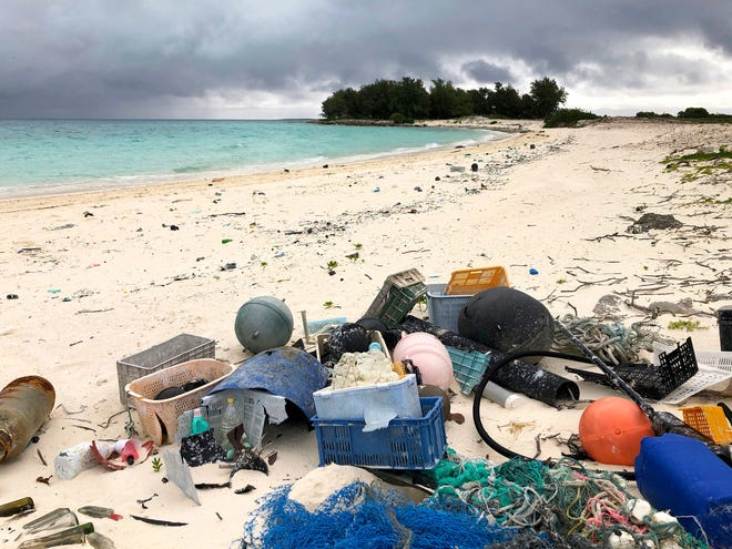 Plastic and other debris sits on the beach on Midway Atoll in the Northwestern Hawaiian Islands in October 2019. According to a study released on Friday, more than a million tons a year of America's plastic trash isn't ending up where it should. The equivalent of as many as 1,300 plastic grocery bags per person is landing in places such as oceans and roadways.