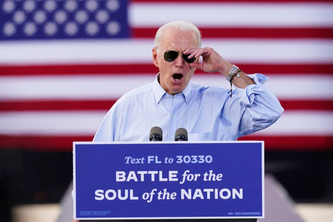 Democratic presidential candidate former Vice President Joe Biden speaks at a drive-in rally at Broward College, Thursday, Oct. 29, 2020, in Coconut Creek.