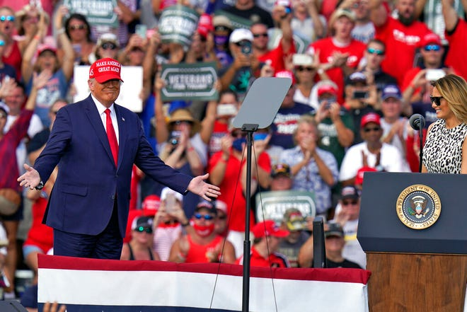 President Donald Trump gestures as he is introduced by first lady Melania Trump during a campaign rally Thursday, Oct. 29, 2020, in Tampa.
