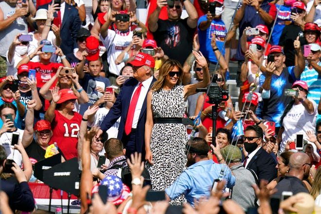President Donald Trump and first lady Melania Trump arrive for a campaign rally Thursday, Oct. 29, 2020, in Tampa.
