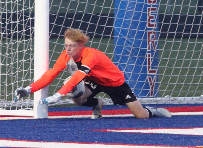 Spartans soccer senior goalkeeper Andrew Imgarten makes a diving stop to prevent an opponent from scoring during a Moberly home game. Moberly (9-7-1) shutout Boonville 8-0 Thursday to guarantee a 2020 winning season heading into district play and snap the progam's six-year losing skid.