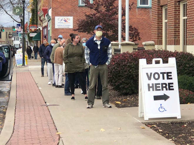 People line up for early voting outside the Victor Town Hall last fall.