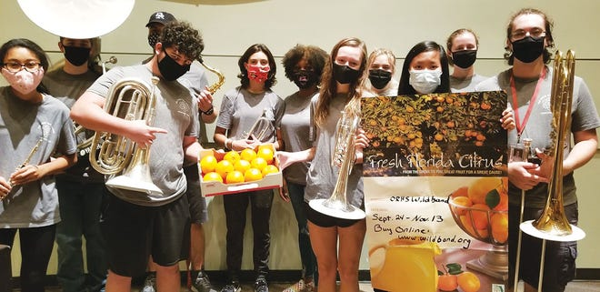 The Oak Ridge High School WildBand — appropriately masked — has once again kicked off its annual fruit fundraiser.