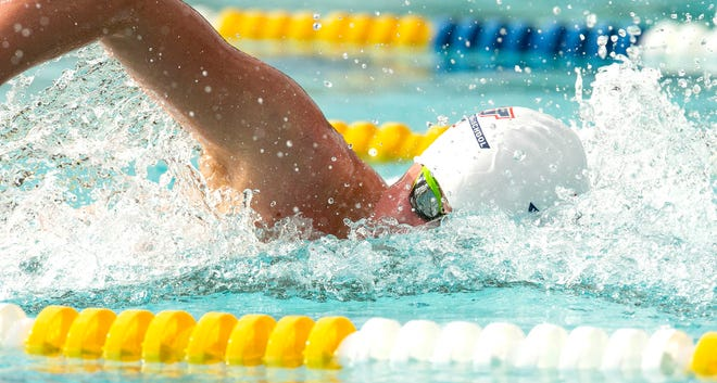 Vanguard's Ethan Russell competes in the Boys 200-yard Freestyle in the Class 2A, District 7 high school swim meet on Thursday.