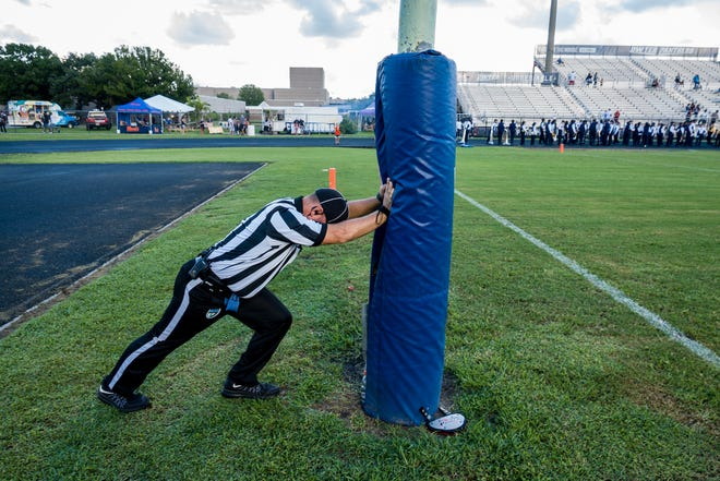 An official stretches before a Dwyer football game in 2018. After Dwyer's game against Forest Hill was cancelled due to a positive COVID test within the Forest Hill program, the Panthers will now play Pahokee on Saturday.