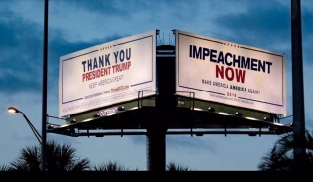Competing billboards at the intersection of I-95 and Southern Boulevard in West Palm Beach, in April 2020.