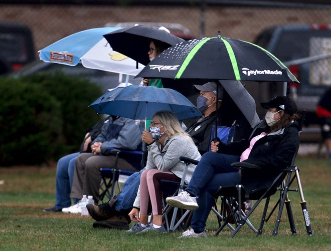 Spectators, such as these folks watching the Pilgrim-Toll Gate girls soccer game on Oct. 20, won't be allowed close to any high school sporting event for the next two weeks as COVID-19 cases in Rhode Island continue to climb.