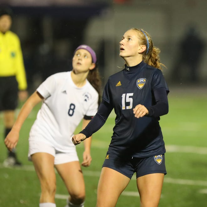 Streetsboro junior Emma Flick, right, looks for the ball during Thursday's district title game against West Geauga High School at Quinn Field.