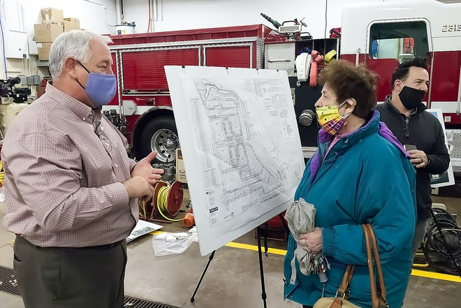 Environmentlal Design Group Principal Bob Warner shares details of the plan for West Village with Rebecca Ebie of Mogadore during a Thursday meeting of the Planning and Zoning Commission.