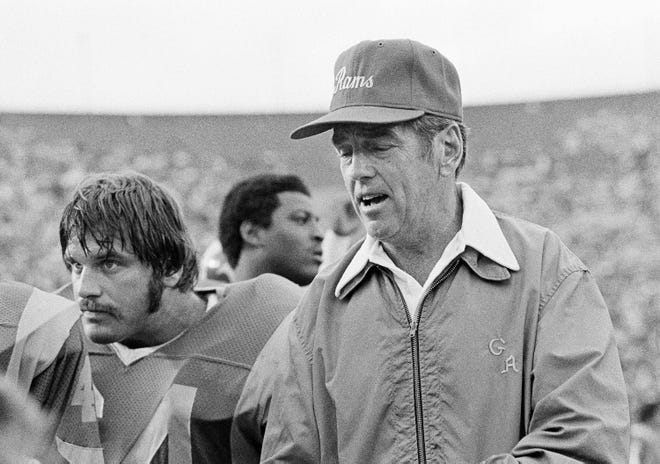 Former Los Angeles coach George Allen is shown talking with his players on the sideline during the exhibition game against the San Diego Chargers on Saturday, August 14, 1978 in Los Angeles. Allen, who coached the Rams for just the two preseason games was fired by Rams owner Carroll Rosenbloom on Sunday. (AP Photo/ George Brich)