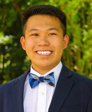 Denny Lu is a scholar with Sarasota UnidosNow who is a high school junior and founding of a peer mentoring program for younger students and who works in his parents' restaurant.