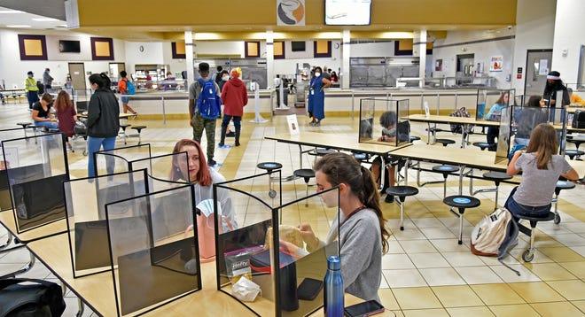 At Booker High School in Sarasota, students in the cafeteria are socially distanced, too.