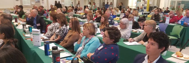Audience members listen to speakers at last year's annual Sarasota County Sustainable Communities Workshop. Due to the pandemic, this year the day-long conference was held entirely online, reducing its carbon footprint.