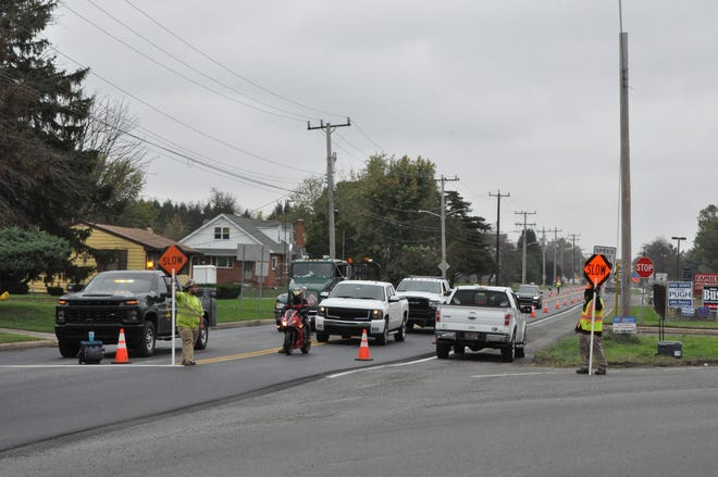 Crews direct traffic on Glenwood Avenue (Route 300) at the intersection with Smyrna-Clayton Boulevard (Route 6) Oct. 28.