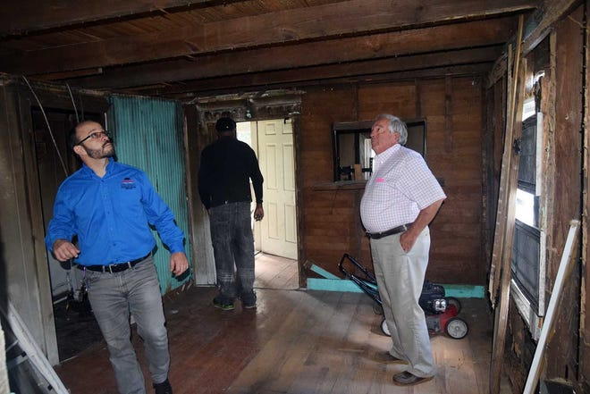 Jeff Ruggieri, director of New Bern Development Services, left, along with Redevelopment Housing Committee member Kip Peregoy look inside a potential purchase property on Jones Street earlier this week.
