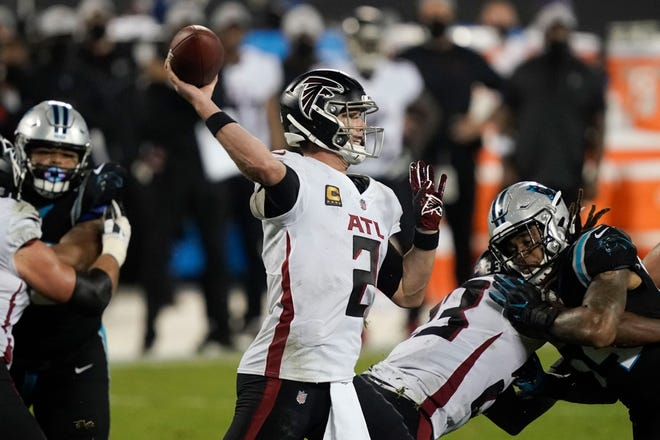 Atlanta Falcons quarterback Matt Ryan passes against the Carolina Panthers during the second half Thursday's game.