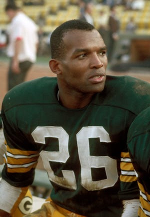 Packers defensive back Herb Adderley sits on bench during the first Super Bowl in 1967 in Los Angeles.