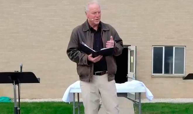 Former pastor of East Saugatuck Christian Reformed Church Keith Mannes leads an outdoor service via Facebook Live in Holland, Mich. Mannes stepped aside from his pastoral role at the church earlier in October after three decades of ministry, saying he loved his church but felt alienated from the broader institution.