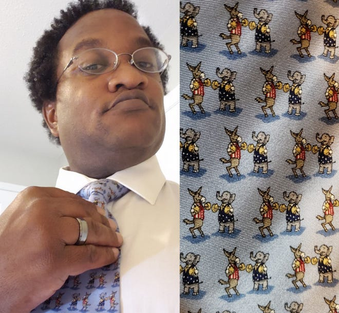 Myron B. Pitts models his favorite election tie, a gift from his wife, who knows how he is.