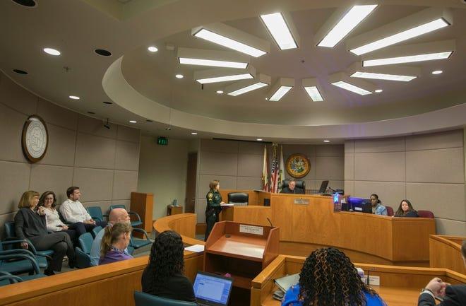 Guardian Ad Litem members listen during court proceedings.
