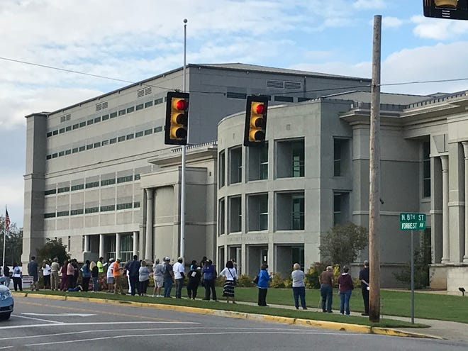 At about 4 p.m. Tuesday, the line of people waiting to vote absentee stretched to the corner outside the judicial building. More than 6,000 voters applied for absentee ballots for the Nov. 3 election.