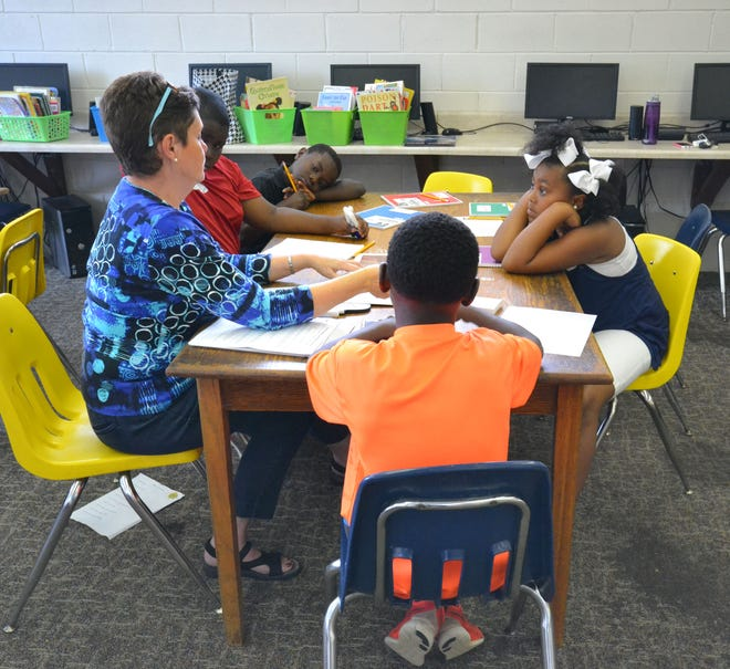 Staff and community volunteers assist summer campers with reading during the two hour Reader Program at Benjamin Barnes YMCA in Tuscaloosa Wednesday, July 13, 2016. The daily program aims to improve literacy techniques and combat summer reading loss.  photo/Lauren DeSeno