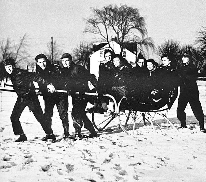 """White is the snow, crisp is the day, and all is fun in a tinkling sleigh."" Robert Jones, Norman Brown, John Bogen and William Connor pull a sleigh carrying Theodora Hannus, Jacqueline Soule, Mary Anderson, Sue Burghalter and Juanita Thompson, all Grandview Heights High School seniors having fun during the winter of 1949. This picture and quote were taken from the 1949 Highlander of Grandview Heights High School, which was dedicated to the Grandview residents ""who have always stood squarely behind our schools."" With enthusiasm as their keynote, the class of 1949 Boosters comprised the entire student body. They planned and carried out assemblies, Club Tropicabana (the winter dance) and the April talent show and conducted the annual magazine campaign. The redecorated school building of 1948-49 inspired a new format for the 1949 Highlander, and co-editors Sylvia Edmundson, Norman Brown and the rest of the staff worked to create the new look for the yearbook."