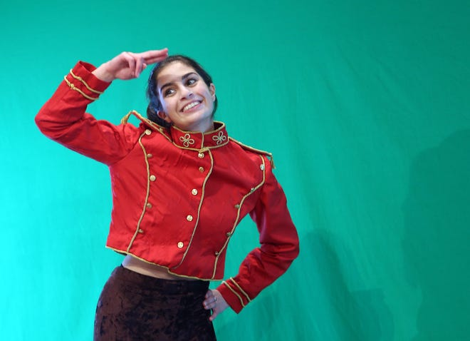 """Grandview Heights High School senior Juliana Bongiorno, as the Singing Telegram, films scenes Oct. 29 for the """"Clue"""" play. The theater department is filming the play on a green screen, and a production team will edit the scenes and add backgrounds so the play can be livestreamed Nov. 13 and 14."""
