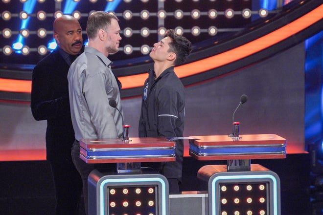"""Boxing superstar Ryan Garcia, right, and retired UFC fighter Forrest Griffin jokingly stare each other down on the set of """"Celebrity Family Feud,"""" which aired Thursday night, Oct. 29, 2020, on ABC."""